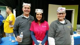 T-G staff at a trivia contest for charity.