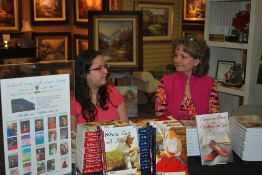 """Authors A.M. Heath(""""Where Can I Flee?"""") and Patty Howell (""""Shoes in the Bible and Walking with God"""") at a book signing."""